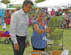 Photos by Stewart F. House/Special Contributor Candidate John Ratcliffe talks with Susan DeKruger of Garland at the Rockwall Founder's Day Festival on Saturday. Ratcliffe says it's time to focus on the next generation.